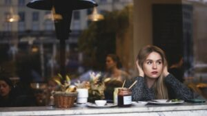 Worried woman in a coffee shop
