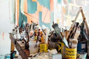 art studio with brushes on table